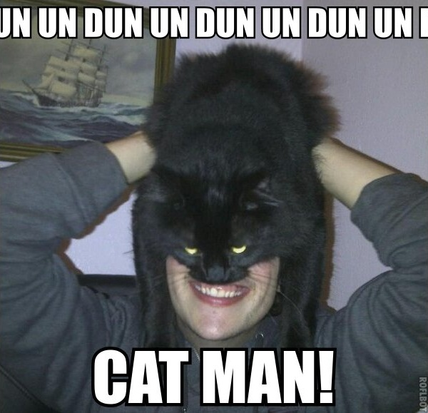 Image of a man wearing his cat as a mask